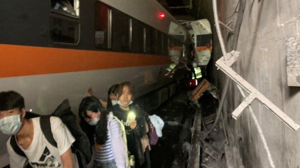 Taiwan: At least 34 killed after train derails inside tunnel - BBC News