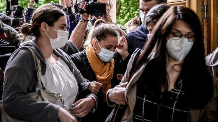 Valérie Bacot (C) arrives flanked by relatives and journalists at the Chalon-sur-Saone Courthouse, central-eastern France, on June 25, 2021