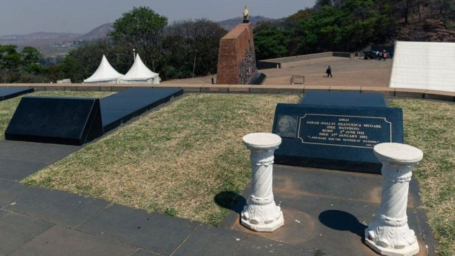 A picture taken on September 12, 2019 shows an empty grave next to the grave of late Zimbabwean President's first wife Sally Mugabe, who lies buried at the National Heroes Acre in Harare, as speculations continue as to where the final resting place of the late president Robert Mugabe will be.
