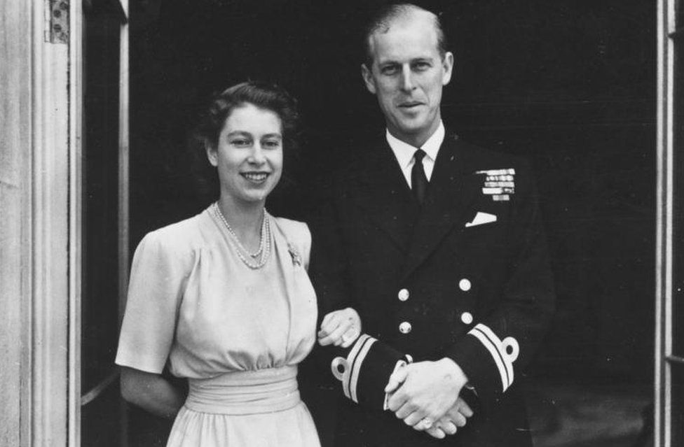 Princess Elizabeth and her husband-to-be smile outside Buckingham Palace in 1947, after publicly announcing their engagement