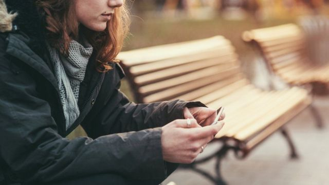 Girl sitting on bench (stock image)