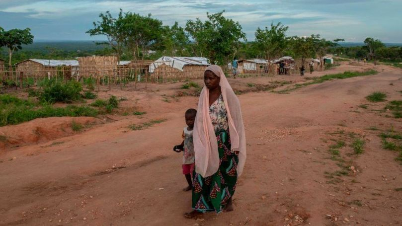 A woman and her child walk in the community of Ntocota, Metuge District in Pemba, Cabo Delgado Province on February 22, 2021
