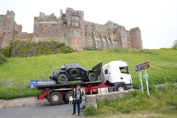 An armoured vehicle arrives on set at Bamburgh Castle