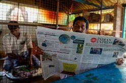 A man reads a newspaper featuring front-page news on US President Joe Biden and Vice President Kamala Harris at her ancestral village of Thulasendrapuram in the southern Indian state of Tamil Nadu on January 21, 2021