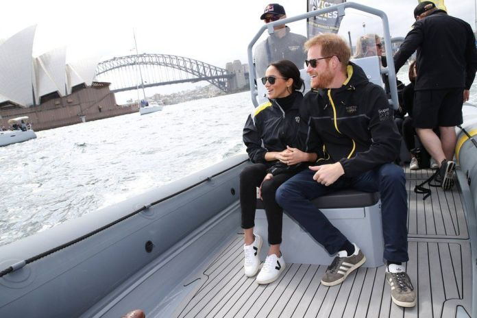 Prince Harry, Duke of Sussex and Meghan, Duchess of Sussex look out at Sydney Opera House and Sydney Harbour Bridge during day two of the Invictus Games Sydney 2018 at Sydney Olympic Park in Sydney, Australia, October 21, 2018