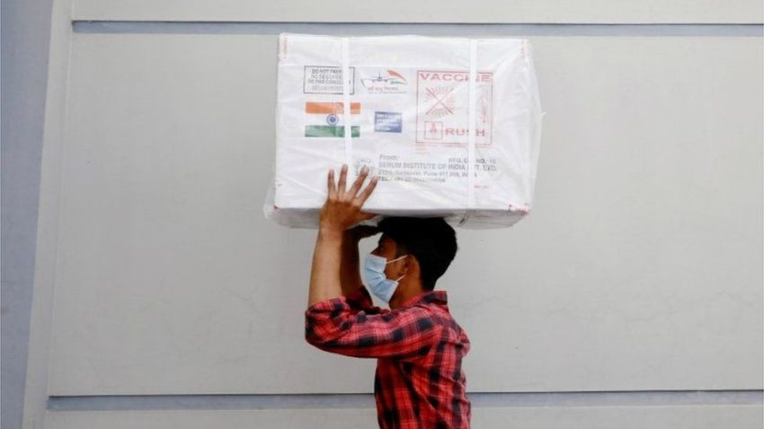A worker carries a package of Oxford-Astrazeneca COVID-19 vaccines that arrived from India as a gift to Bangladesh, in Dhaka, Bangladesh January 21, 2021