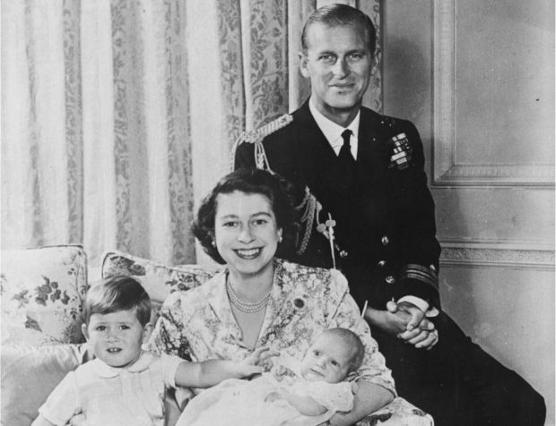 A portrait of Princess Elizabeth and Prince Philip smiling with their baby daughter Princess Anne and son Prince Charles at Buckingham Palace, London, on 21 October, 1950