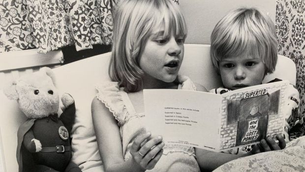 Mike's stepson Richard being read a SuperTed book by Mike's daughter Sarah in the early 1980s