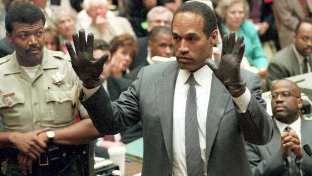 OJ Simpson shows the jury a pairs of gloves he was asked to wear during the trial