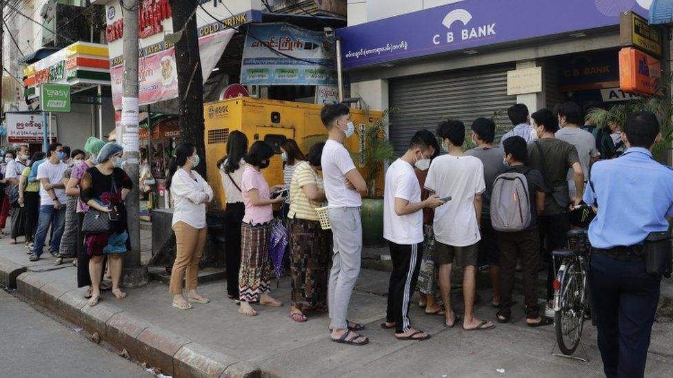 Myanmar people line up in front of an ATM of a closed bank in Yangon, Myanmar, 01 February 2021