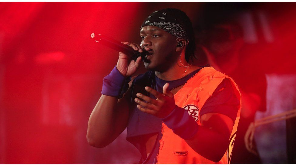 KSI performing on stage