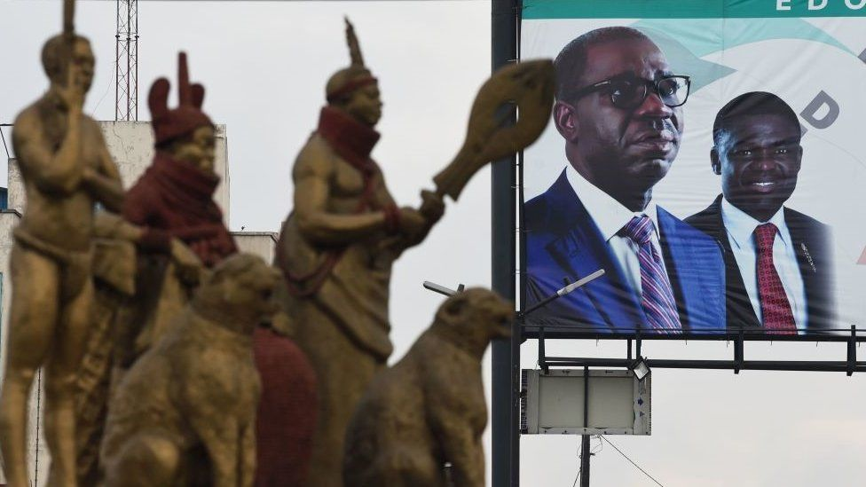 This photograph taken on September 19, 2020 shows a billboard showing incumbent governor of Edo State and candidate of Peoples Democratic Party (PDP) Godwin Obaseki and deputy Philip Shaibu during the Edo State governorship elections
