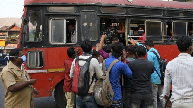 A crowd of people boarding a public transport bus in Mumbai. Covid-19 cases are spiralling in Maharashtra state as people are not maintaining social distance while travelling to work.