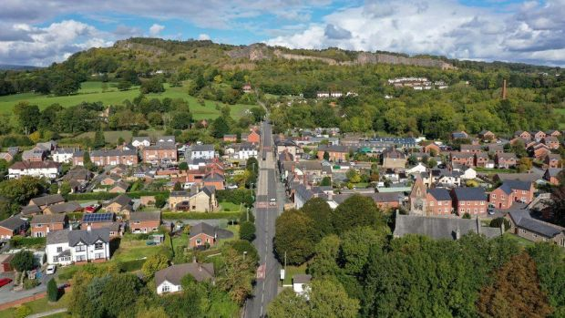 An aerial drone view of the border village of Llanymynech which is split by the border with England, right, and Wales, left