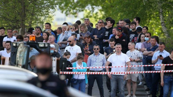 People gather at school No 175 following the attack