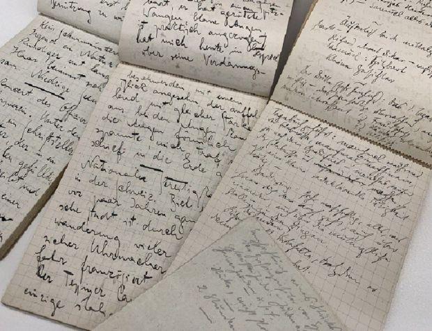Three notebooks showing Paris travel journals written by Franz Kafka in 1911