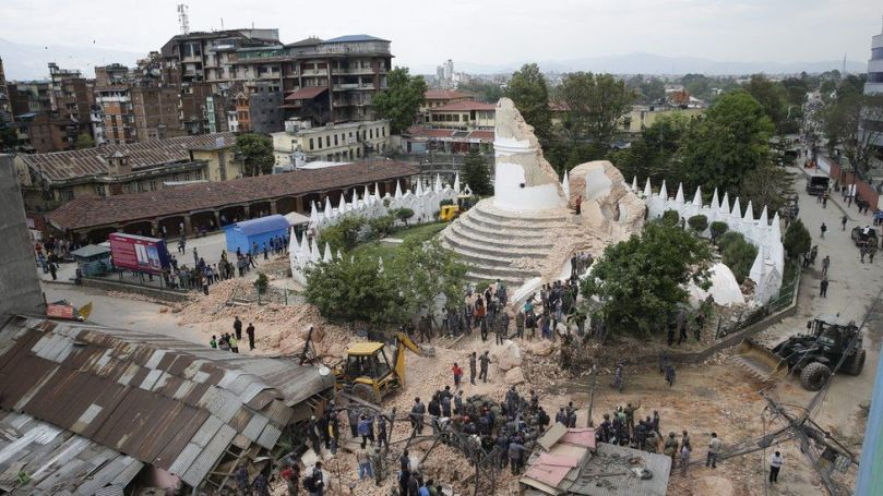 People inspect the damage of the collapsed landmark Dharahara, also called Bhimsen Tower, Kathmandu, 25 Apr 2015