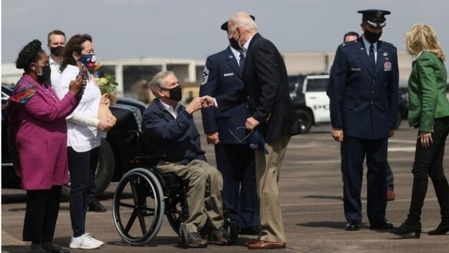 President Biden gave Republican Governor Greg Abbott a fist-bump after he landed in Houston