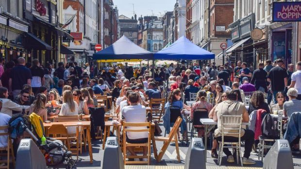 Busy restaurants in Soho in central London on Sunday