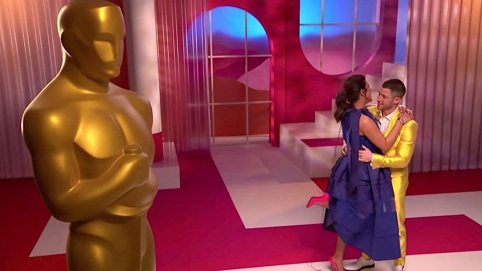 Priyanka Chopra Jonas and Nick Jonas embrace at the 93rd Academy Awards Nominations Announcement on March 15, 2021