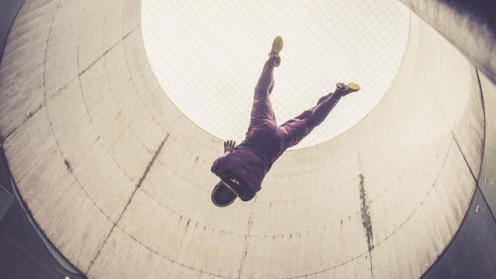 Stock image of person indoor skydiving