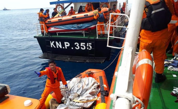 Search and rescue officials in the sea off Jakarta