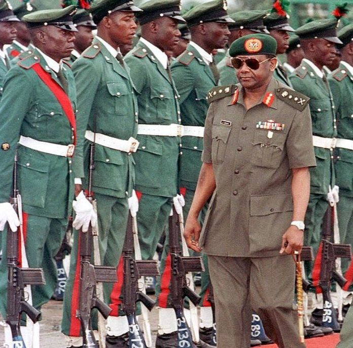 1996 photo shows Sani Abacha at the airport of Abuja in front of soldiers