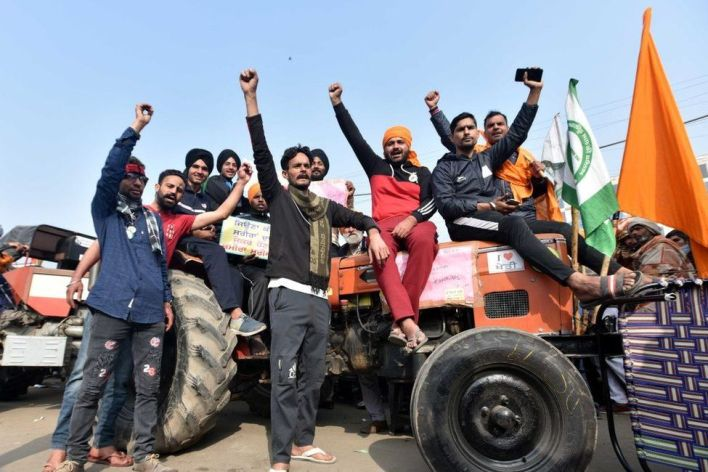 Farmers with his tractor arrive for enter in the capital for Tractor Republic Day parade rally during their farmers' ongoing agitation over the new farm laws, at Singhu border on January 25, 2021 in New Delhi,