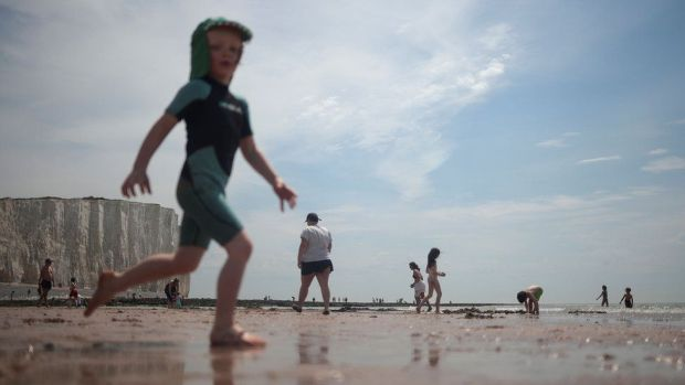 Children enjoy the weather during a hot day near the Seven Sisters Cliffs, at Birling Gap, in East Sussex