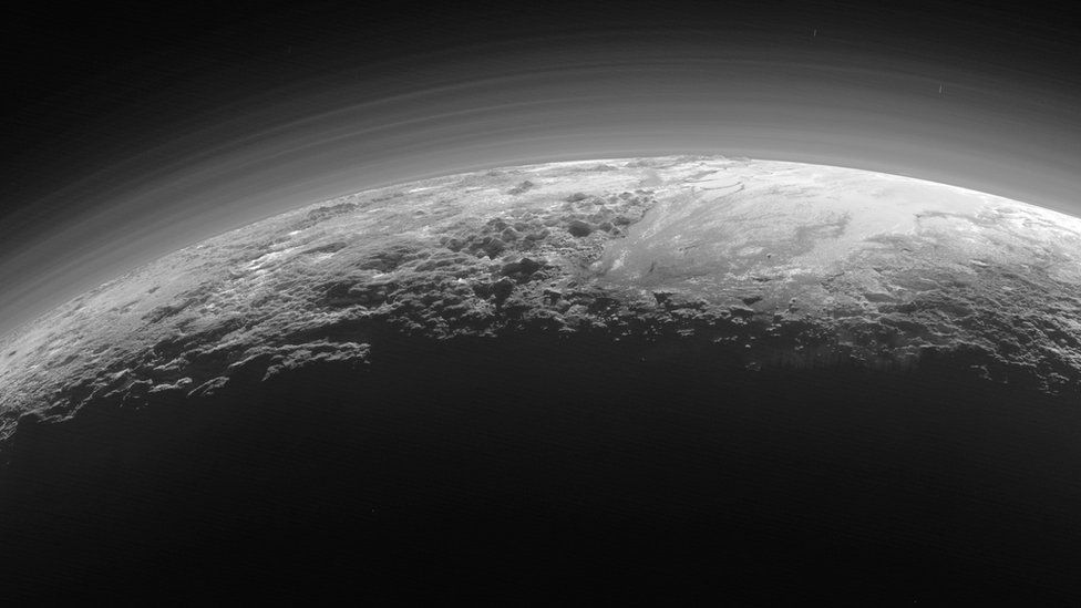 Low-lying haze clinging to the surface of Pluto