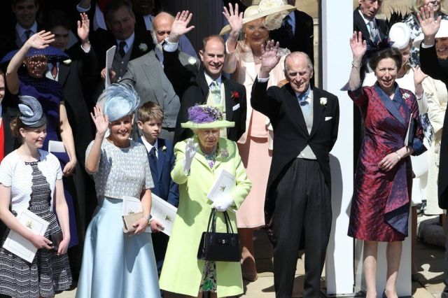 The Queen, Duke of Edinburgh and other members of the Royal Family wave at the Duke and Duchess of Sussex's wedding in May 2018