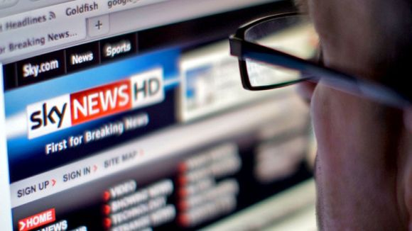 A stock image of a man looking at the Sky News website