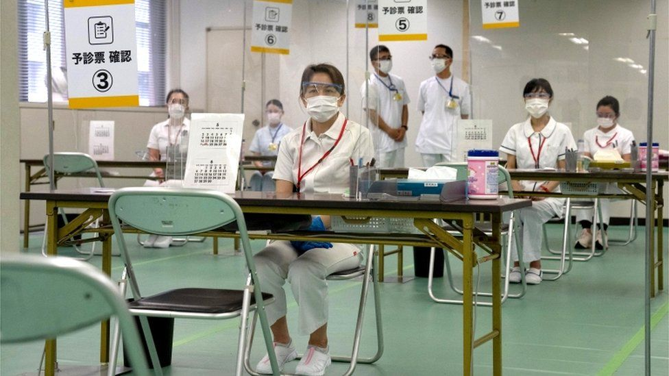 Nurses waiting for patients to arrive for their vaccinations