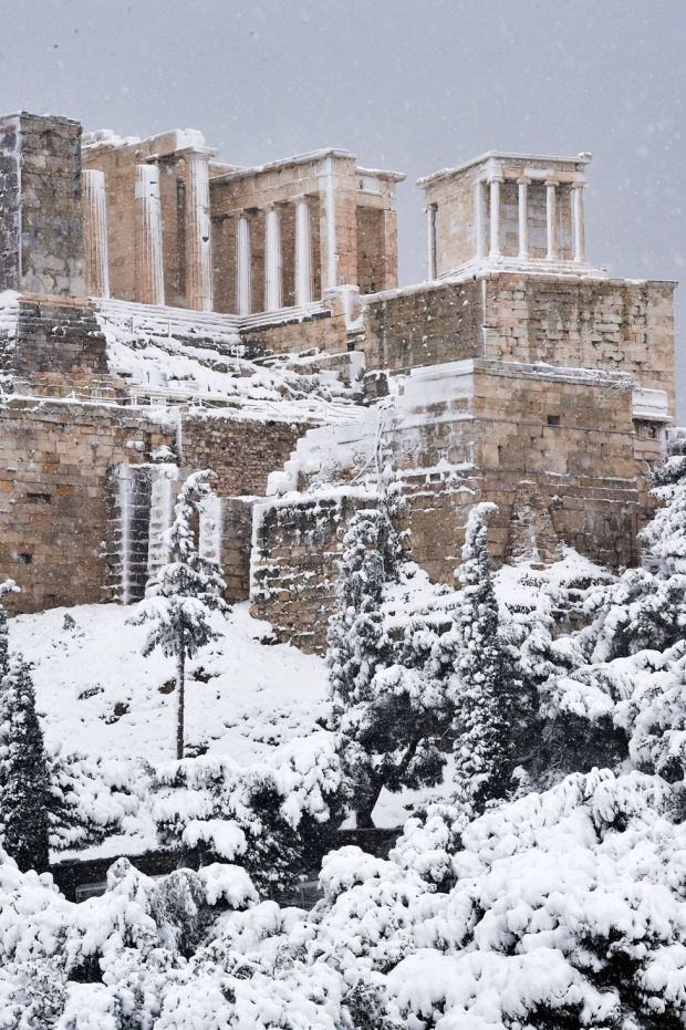 Snow falls on ancient ruins in Athens