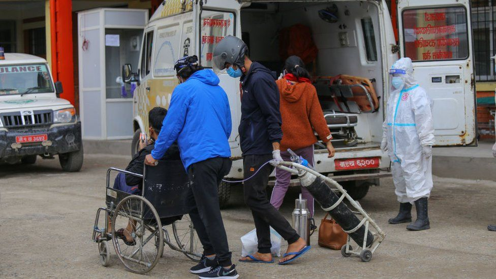 A man infected with Covid-19 arrives at hospital in Kathmandu
