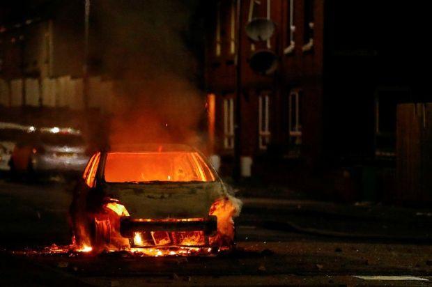 A car on fire on a street in Belfast