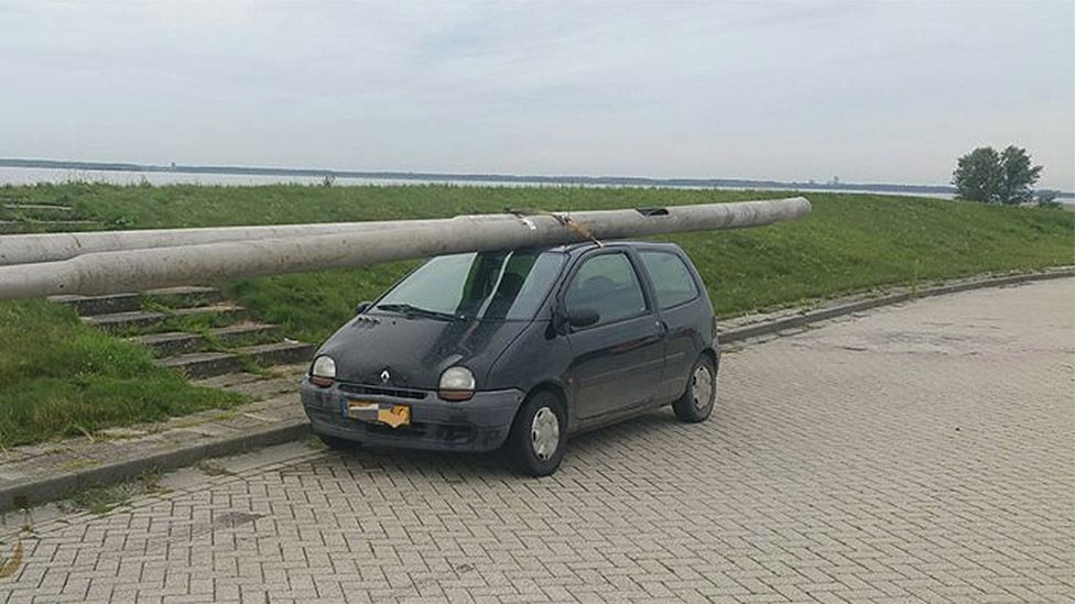 Car with lampposts