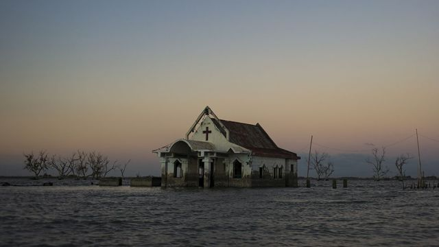 Sea water engulfed houses, buildings, schools, and the streets of Pariahan village , on November 26, 2018 in Bulacan, north of Manila.