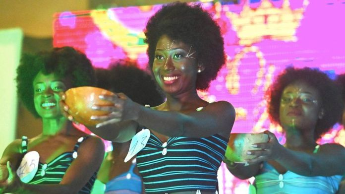 Miss Nappy contestants hold out bowls during the event in Abidjan, Ivory Coast - Saturday 16 November 2019