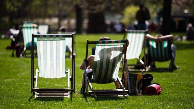 Sunbathers in St James' Park, London