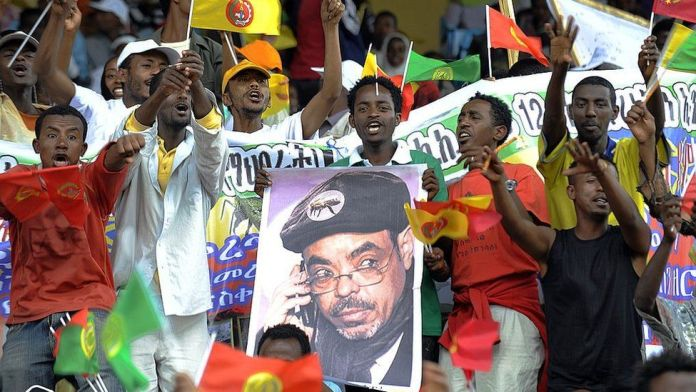 Supporters of Ethiopia's People Revolutionary Front (EPRDF) carry a poster of Prime Minister Meles Zenawi on May 20 2010, on the last day of campaigning ahead of the election scheduled for this weekend