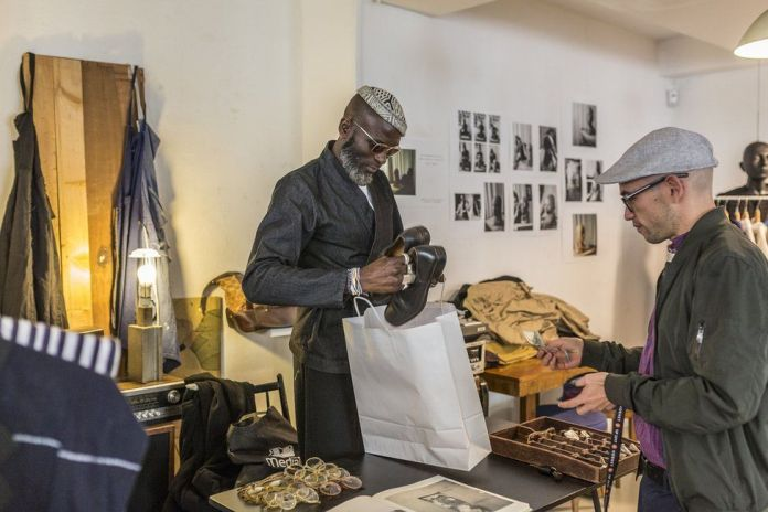 A customer makes a purchase at the till in Marche Noir.