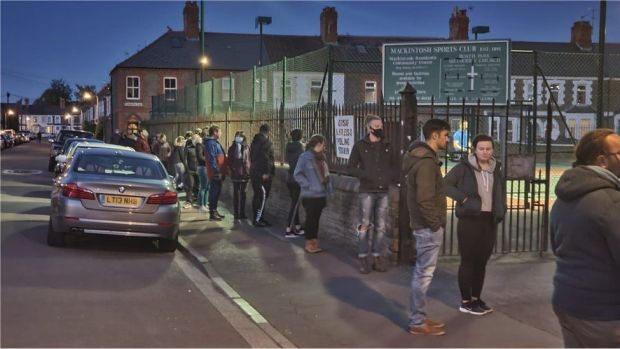 People seen queuing in Cardiff