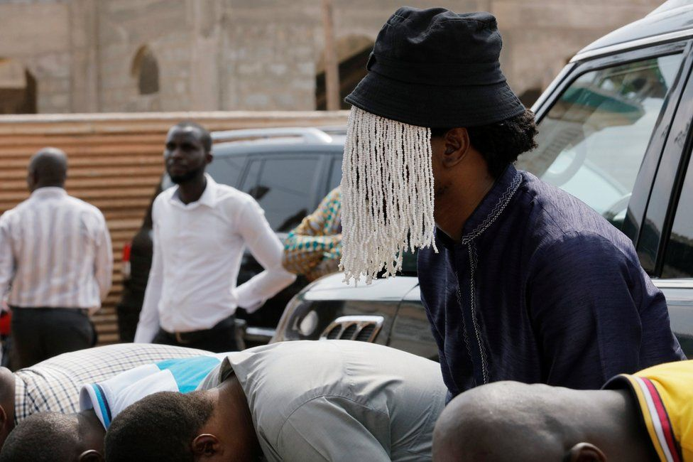 Undercover journalist Anas Aremeyaw Anas prays with others for his slain colleague Ahmed Hussein-Suale, an investigative journalist who was killed by gunmen on Wednesday, at Madina Central Mosque in Accra, Ghana January 18, 2019