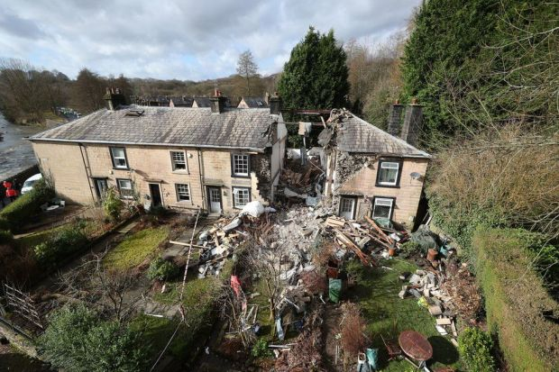 An aerial view of a collapsed terrace house in Bury, Greater Manchester