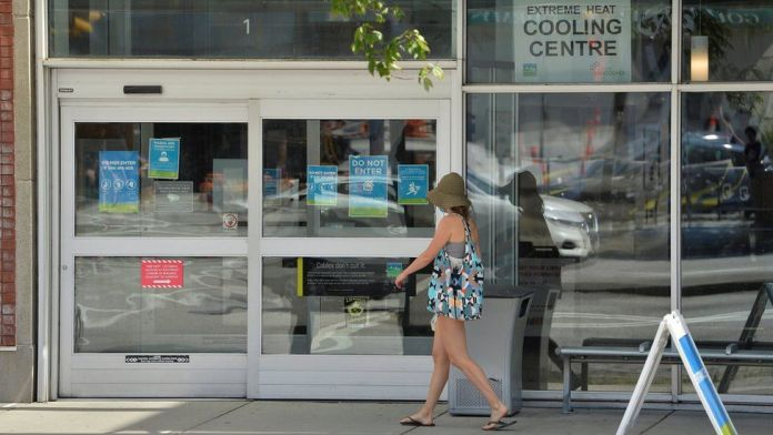 A woman enters a cooling centre during the scorching weather of a heatwave in Vancouver