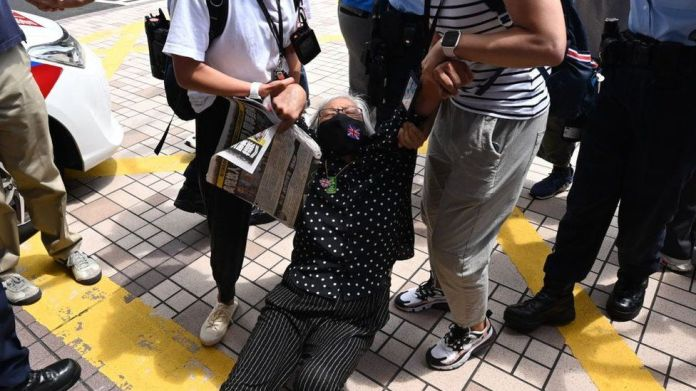 Activist Alexandra Wong is dragged away by police inside court grounds on 19 June