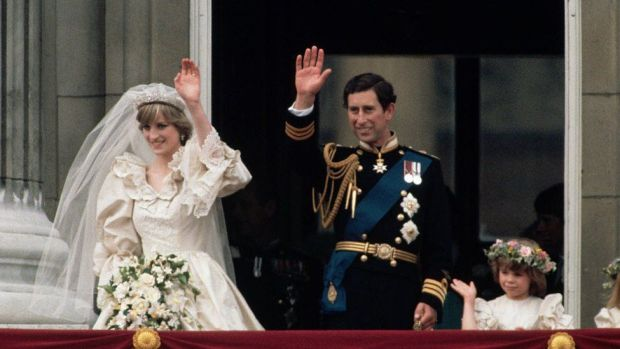 Princess Diana and Prince Charles wave to onlookers from the balcony at Buckingham Palace just after their wedding, attended by young members of the bridal party