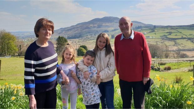 Eimear's parents and children during a trip home