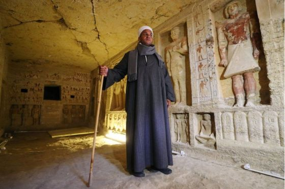 Mustafa Abdo, chief of excavation, stands inside the newly-discovered tomb of Wahtye